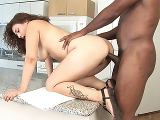 Latina slut takes black cock on the kitchen counter