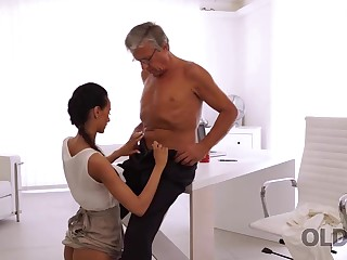 Incredible grey together with young sex exemplification right in the office