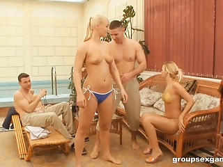 Opprobrious kirmess moans while getting spooked at a steamy groupsex shoot