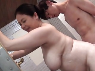 Chubby Japan mom bends over be useful to a young cock