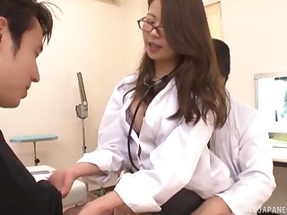 Kinky Japanese doctor gets fucked from behind and receives a creampie